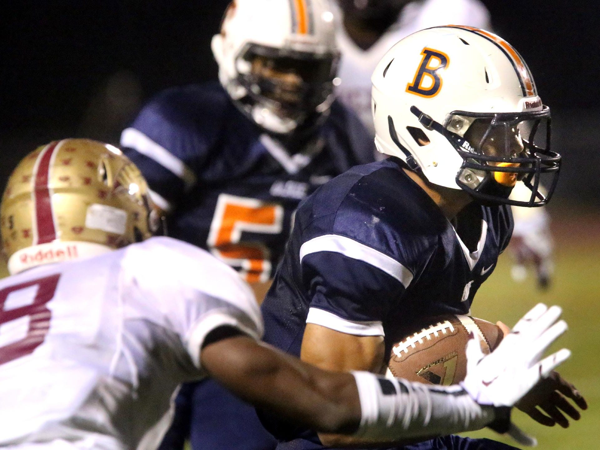 Blackman's Taeler Dowdy (3) runs the ball as Tucker's Demarko Durr moves in for the tackle at Blackman Friday Sept. 11, 2015.