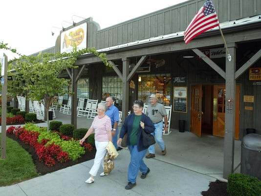 Customers leave a Cracker Barrel restaurant in Franklin, Ky., Thursday, Sept. 12, 2002. The U.S. Justice Department is investigating discrimination claims against Cracker Barrel Old Country Store Inc., the restaurant company's parent said Thursday. Cracker