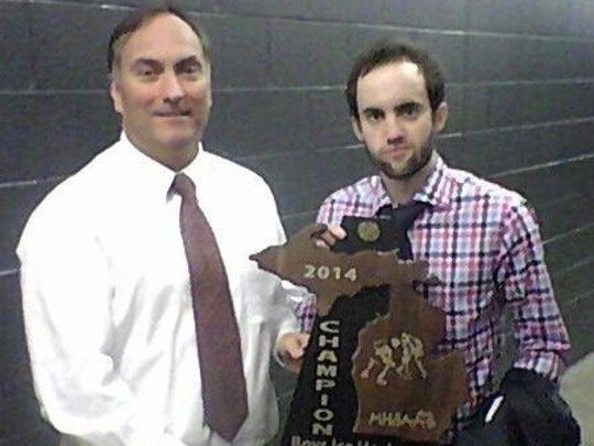 In a father-and-son moment, then-Farmington head coach