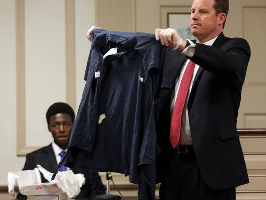 Defense lawyer Joseph Corazza holds up a torn shirt belonging to former Kinnelon resident Francis Thomas, charged with attempting to murder his mother's ex-boyfriend at a home they shared in Smoke Rise development in Kinnelon testifies in his defense in Morris County Superior Court. April 25, 2017, Morristown, NJ