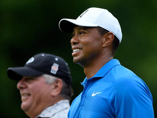2018-6-27-tiger-woods-smile