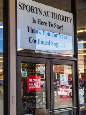 A sign hangs inside the window at Cedar City's Sports Authority Thursday afternoon, March 10, 2016.