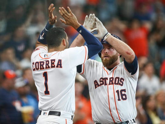 Catcher Brian McCann (right) and shortstop Carlos Correa have vaulted the Astros into first place in the AL West.