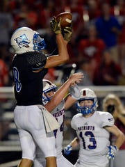 Nolensville cornerback Tim Coutras (8) intercepts a pass intend for Page running back Jackson Satterfield (44) during the second half of an high school football game  Friday, August 24, 2018, in Nolensville, Tenn. Page won 38-35.