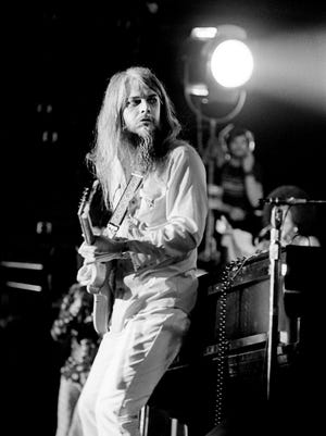Leon Russell plays a cool bogy guitar in a rock performance that had thousands dancing and prancing on top of their seats April 28, 1973 at Middle Tennessee University.