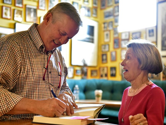 Author John Grisham signs his book, Camino Island, for Madison resident Martha Jones at Lemuria Books in Jackson.