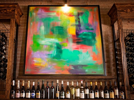 The bar at Raw 1899 is accented with bold art.