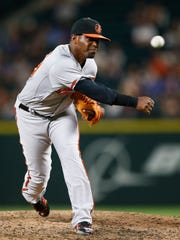 Baltimore Orioles pitcher Mychal Givens (60) throws against the Seattle Mariners during the sixth inning at Safeco Field.