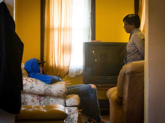 Doviea Lee speaks with a resident at Change Transitional House, a facility for sex offenders, in Wilmington.