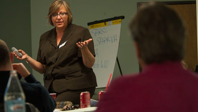 Tracey Spencer, the Sexual Assault Response coordinator at Holloman Air Force Base, educates military and civilian agencies at the Presbyterian Medical Services Behavior Health Office in Alamogordo, New Mexico, on Nov. 10. The training taught different options victims have to report sexual assault. This training, held by Holloman, was designed to coordinate military and local civilian agencies' efforts in responding to sexual assault.