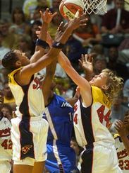 FILE -- Vicki Hall (right), playing for the Indiana