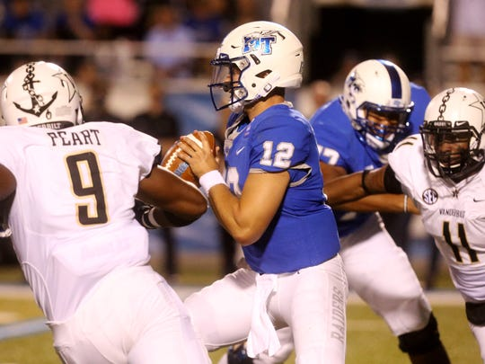 """Vanderbilt linebacker Charles Wright (11) moves into sack Middle Tennessee quarterback Brent Stockstill (12) during the first half of an NCAA college football game at Johnny """"Red"""" Floyd Stadium in Murfreesboro, Tenn., Saturday, Sept. 2, 2017."""