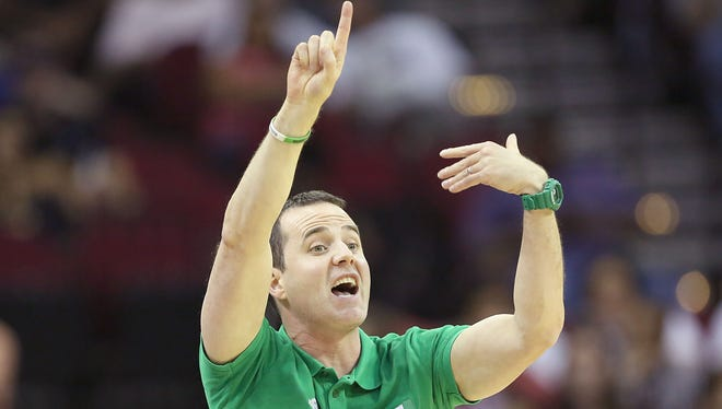 Aug 1, 2016; Houston, TX, USA; Nigeria head coach Will Voigt gives directions to his players while they play against  the United States in the second quarter during an exhibition basketball game between United States and Nigeria at Toyota Center.