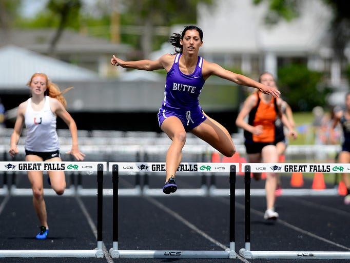 Butte's Erika McLeod clears her final hurdle in the 300m low hurdles during the Class AA state track meet on Saturday at Memorial Stadium in Great Falls, Mont.