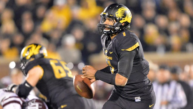 Missouri quarterback James Franklin (1) rolls to the outside against Texas A&M Aggies during the second half last Saturday urot Field. Missouri defeated Texas A&M 48-21 and clinched the SEC East title.