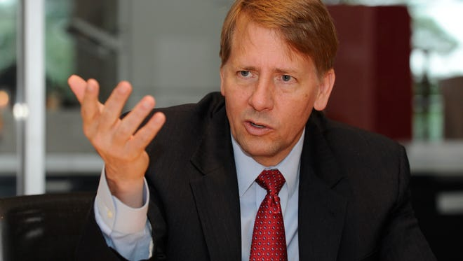Richard Cordray, head of the Financial Consumer Protection Bureau, speaks with USA TODAY's Editorial Board in 2013.