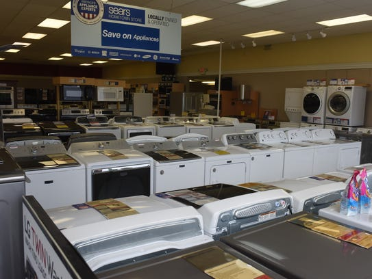 Appliances sit out on display Friday at the Sears Hometown