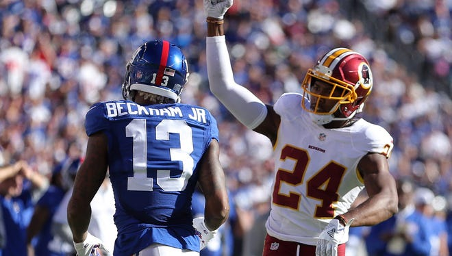 Washington Redskins cornerback Josh Norman (24) reacts after stopping New York Giants wide receiver Odell Beckham Jr. (13) short of a first down during the fourth quarter at MetLife Stadium last Sunday.