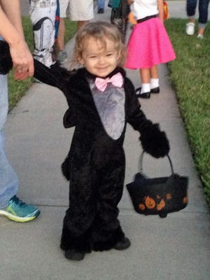 Isabella loved carrying her bucket around while trick-or-treating on Monday night.
