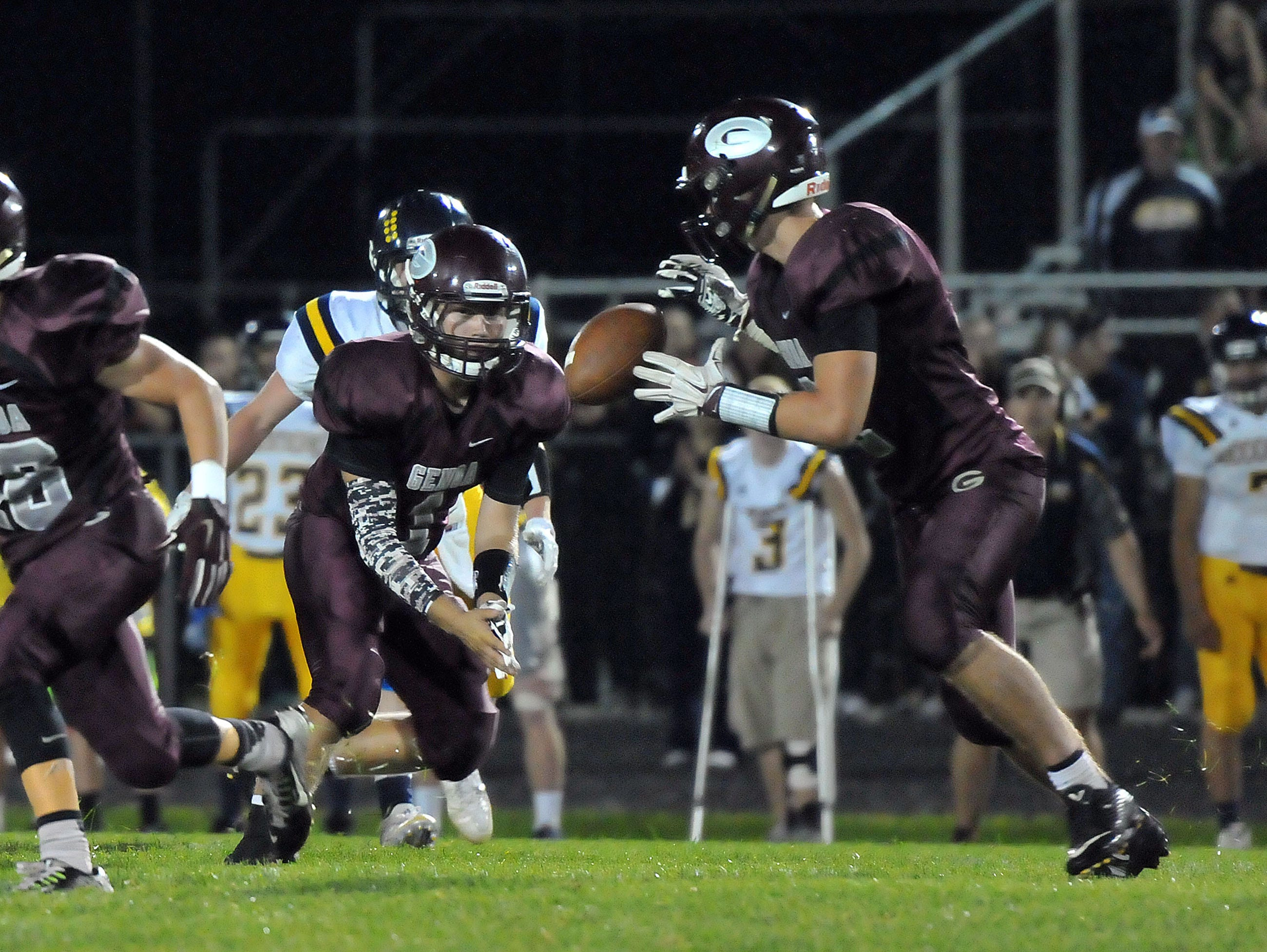 Genoa's Zach Grodi passes the ball to Jacob Plantz during the Comets home game versus Woodmore on Friday night.