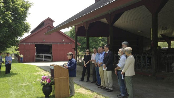 Diane Bothfeld, Vermont's deputy agriculture secretary, speaks at Vermont Technical College's new 40-stall operational dairy farm Thursday in Norwich. The school soon will be training agriculture students on the 350-acre dairy farm that was donated to the school.