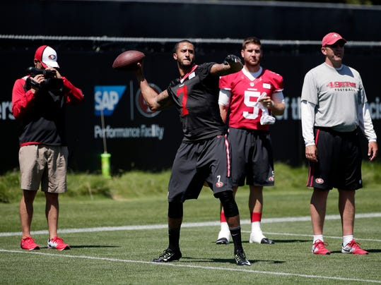 San Francisco 49ers quarterback Colin Kaepernick (7) is videoed as he throws during an NFL football training camp on Friday, July 25, 2014, in Santa Clara, Calif. (AP Photo)