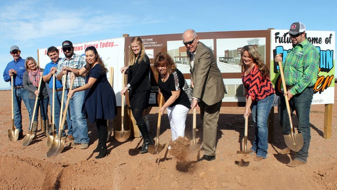 In this file photo, Commissioner Erica Martin, Acting City Manager Maggie Paluch, Commissioner Susan Payne and Mayor Richard Boss move the first shovels full of dirt during the Family Fun Center's groundbreaking ceremony.