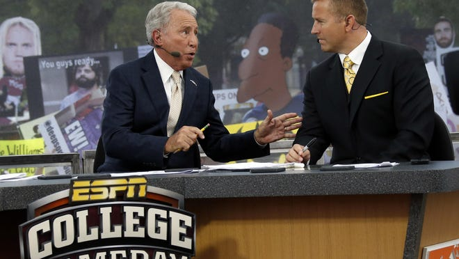 FILE - In this Oct. 11, 2014, file photo, ESPN College GameDay hosts Lee Corso, left, and Kirk Herbstreit confer during the telecast.