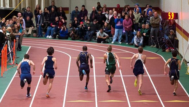 Runners charge toward the finish line in the Division I boys 55 meter dash during the Vermont indoor track state championships on Saturday at Norwich University.