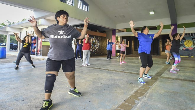 "This April 29, 2015, file photo shows the ""Z -Awesome Crew"" during one of three weekly Zumba classes previously held at the Barrigada Community Center. Many villages currently hold fitness classes."