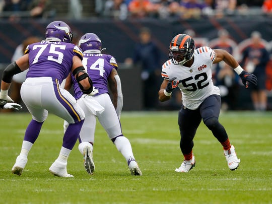 Chicago Bears outside linebacker Khalil Mack (52) takes up his position against Minnesota Vikings tight end Irv Smith (84) and offensive tackle Brian O'Neill (75) during the half of an NFL football game Sunday, Sept. 29, 2019, in Chicago. (AP Photo/Charles Rex Arbogast)