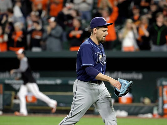 Tampa Bay Rays relief pitcher Danny Farquhar walks off the field at the end of a baseball game against the Baltimore Orioles in Baltimore, Wednesday, April 26, 2017. Farquhar walked Baltimore's Seth Smith with the bases loaded and Craig Gentry scored on the play. Baltimore won 5-4 in 11 innings. (AP Photo/Patrick Semansky)