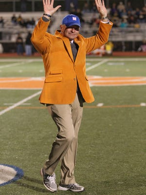 Madison Central Head Football Coach Bobby Hall waves to the crowd prior to their football game against Northwest Rankin on Friday, October, 31, 2014 in Madison. Photo by Keith Warren