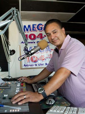In a 2011 photo, Alex Santa Maria is seen working the morning shift at KAJM-FM (104.3), known as Mega.