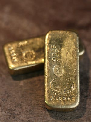 Two gold ingots in Paris.
