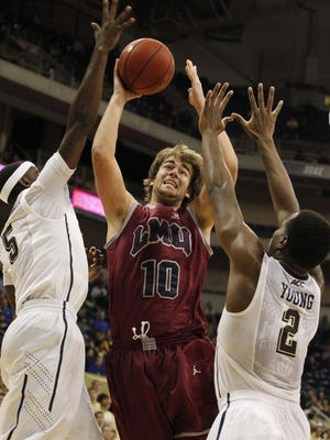 Loyola Marymount Lions forward Ben Dickinson (10) shoots the ball as Pittsburgh Panthers forwards Durand Johnson (5) and Michael Young (2) defend during the second half at the Petersen Events Center in Dec. 2013.