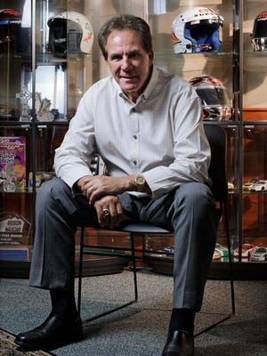 In this July 19, 2011 file photo, former NASCAR driver Darrell Waltrip sits in his Franklin, Tenn., office. Waltrip has made a living from running his mouth, with a trash-talking style that helped him become a NASCAR superstar and led to a second career as a television analyst. Now the three-time champion is headed into NASCAR's Hall of Fame.