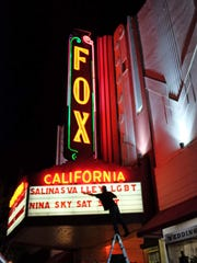 In this file photo, a worker from the Fox Theater finishes marquee lettering for the upcoming 2015 Salinas Valley Pride event.