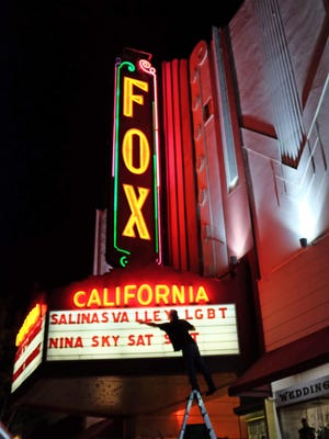 A worker from the Fox Theater finishes marquee lettering for the upcoming 2015 Salinas Valley Pride event on Saturday, September 12.