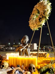 A Day of the Dead altar rises in the parking lot of Foods Co in east Salinas.