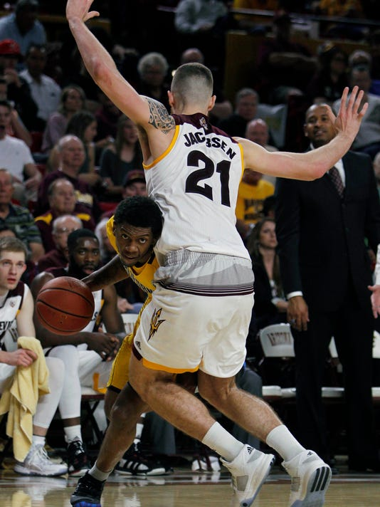 California guard Tyrone Wallace, left, dribbles the ball against Arizona State forward Eric Jacobsen (21) during the first half of an NCAA college basketball game in Tempe, Ariz., Saturday, March 5, 2016. (AP Photo/Ricardo Arduengo)