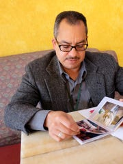 Looking through pictures of his children, now grown, Faustino Orejel is grateful for his health.