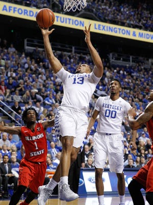 Kentucky Wildcats guard Isaiah Briscoe (13) shoots the ball against Illinois State Redbirds guard Paris Lee (1) at Rupp Arena as the Wildcats' Marcus Lee looks on in November.