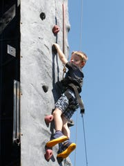 Four-year-old Bennett Pohlar of Lafayette climbed the