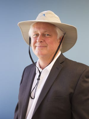 Inventor Andy Birutis wears one of his sun hats at Alchemi Labs headquarters in Scottsdale on Sept. 30, 2016. Birutis won a $50,000 grant for the company through Pfizer's Project Get Old for using radiant barriers in hats to reflect heat and UV light from the sun.