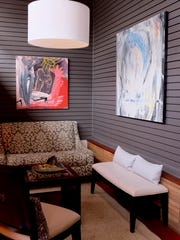 A small sitting area in the storefront windows of the