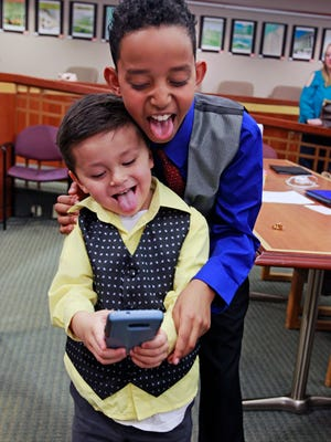 Caleb Duda, 4, and his older brother, Elijah, 10, make funny faces after Caleb's adoption while taking a selfie.