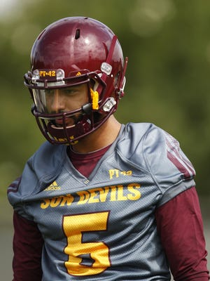 Quarterback Manny Wilkins (5) warms up before practice. Arizona State held their first football practice on Tuesday at Verde Dickey Dome.