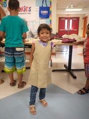 Elizabeth Ochoa, 5, shows off her new school uniform