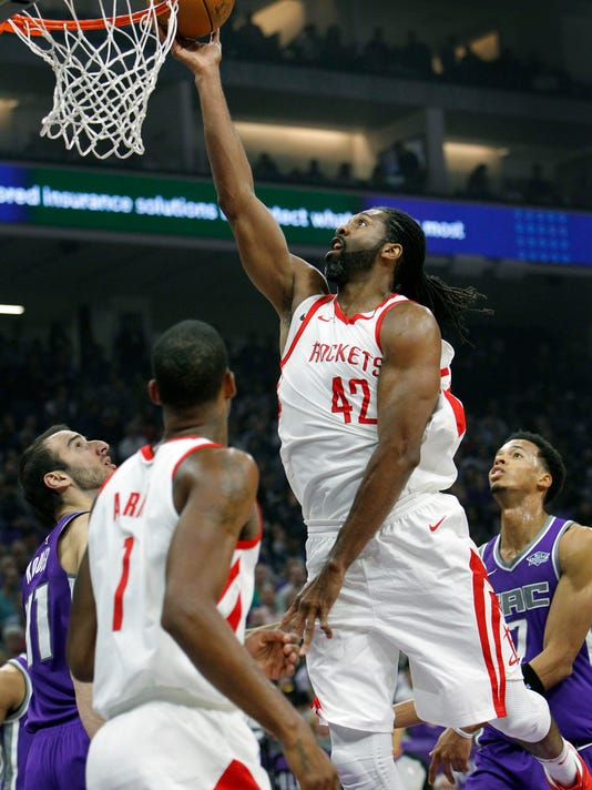 Houston Rockets center Nene (42) drives through Sacramento Kings defenders for a basket during the first half of an NBA basketball game in Sacramento, Calif., Wednesday, Oct. 18, 2017. (AP Photo/Steve Yeater)